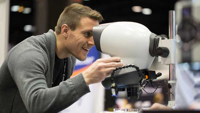 A male neuroscientist uses new lab equipment.