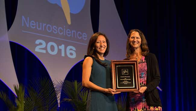 Kay Tye receives an award.