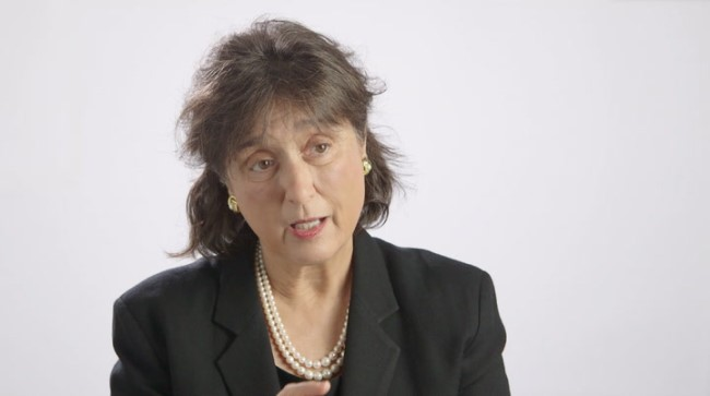 Roberta Diaz Brinton, PhD speaking in front of a white background