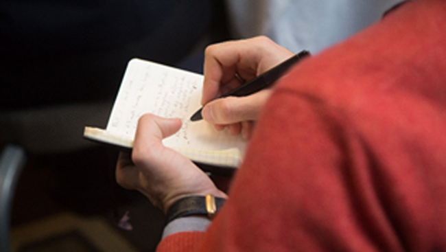 Person writing in a notebook