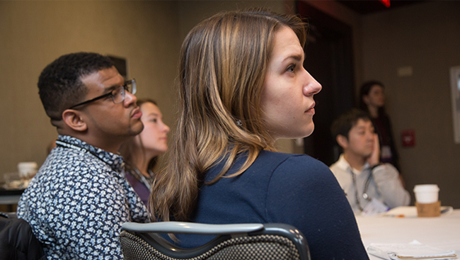Attendees listening to a lecture at Neuroscience 2017