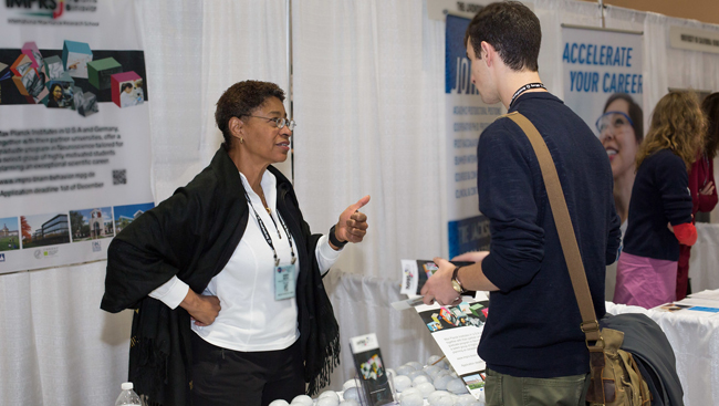 Attendee visiting grad school booths at Neuroscience 2017