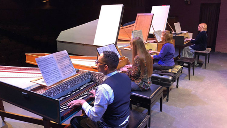 Patricia Izbicki, author of the article, plays piano with three other musicians.
