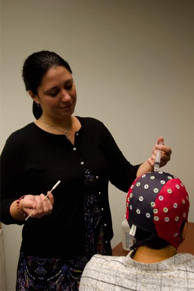 Image of a postdoctoral fellow Amy Starosciak preparing for EEG recordings.