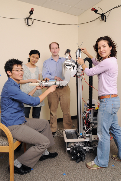 The robot Cody inspired by Ting's collaboration with Madeleine Hackney. The project aimed to develop principles for designing a robot that used physical interactions to assist gait. From left to right: computer scientist C. Karen Liu, roboticist Charlie Kemp, and rehabilitation scientist Madeleine Hackney. Photo Credit: Georgia Tech