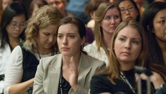 A group of female neuroscientists listening to a seminar.
