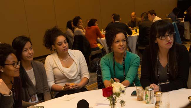 Five female neuroscientists listen to a speaker at the Celebration of Women in Neuroscience Luncheon.