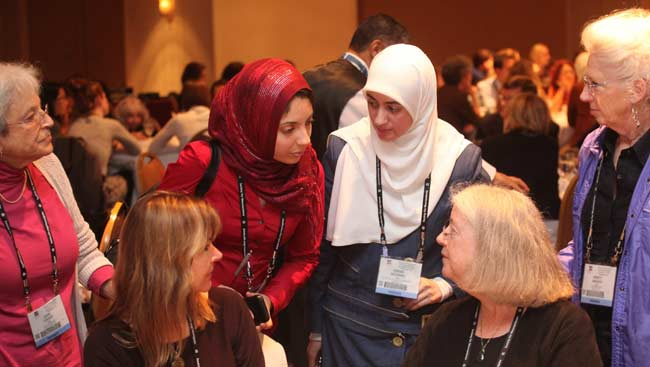 Female neuroscientists talking at SfN's annual meeting.