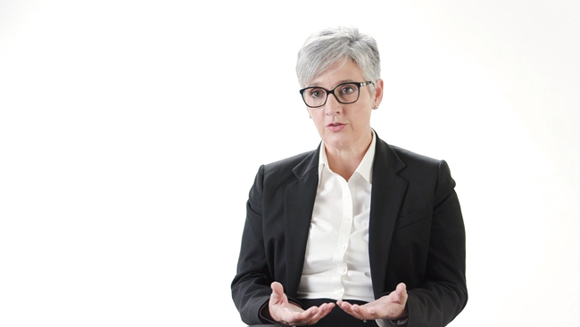 Magda Giordano sitting in front of a white backdrop discussing how to advocate for yourself