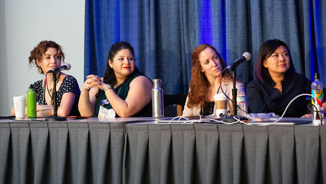 Four women sitting at a table for a Professional Development Workshop panel at Neuroscience 2018.