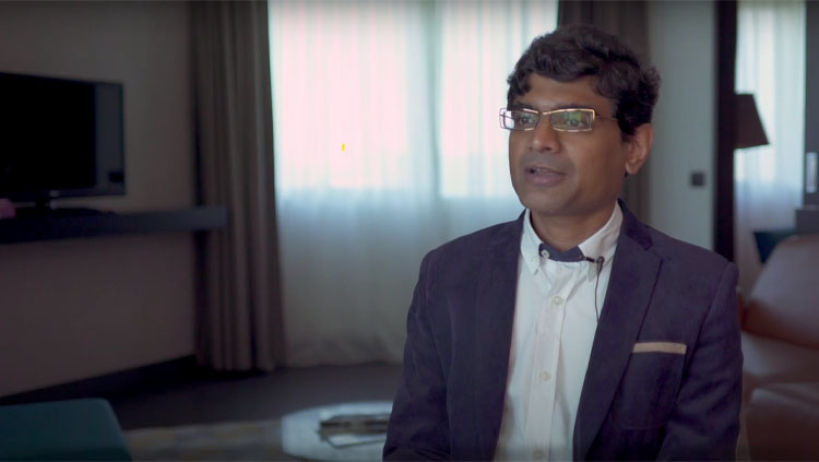 Srikanth Ramaswamy sitting in front of a window during an interview.