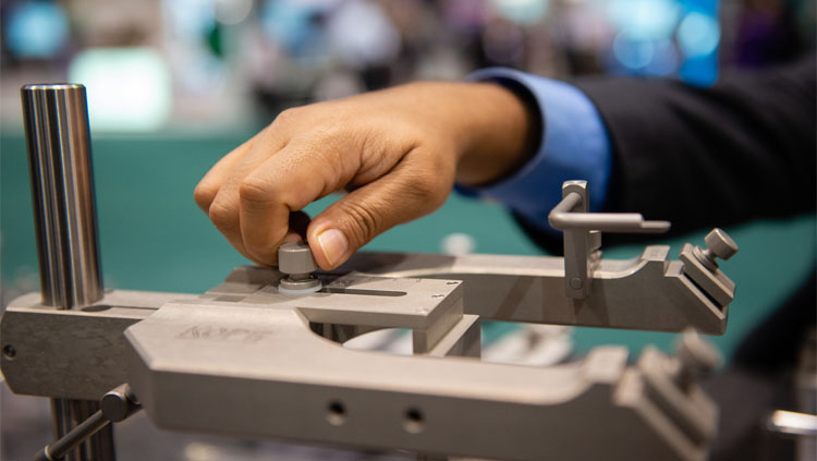 An image of a hand adjusting the base of an instrument