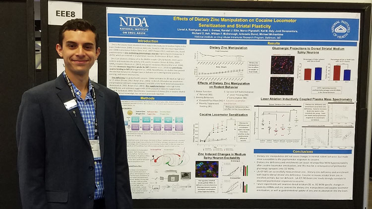 Lionel Rodriguez poses with his poster at the Society for Neuroscience annual meeting.