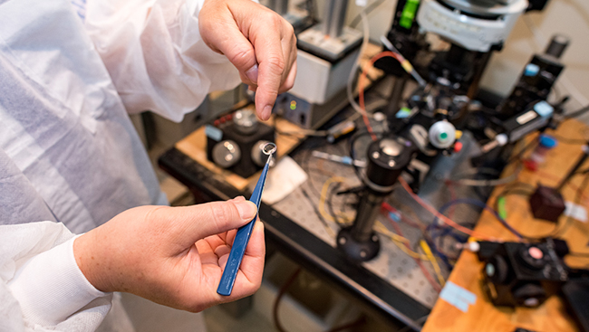 close up photo of scientist handling an instrument