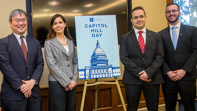 Four people stand around a sign during  SfN's Capitol Hill Day 2017