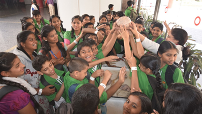 Group of kids holding a brain at Bengaluru's Brain Museum
