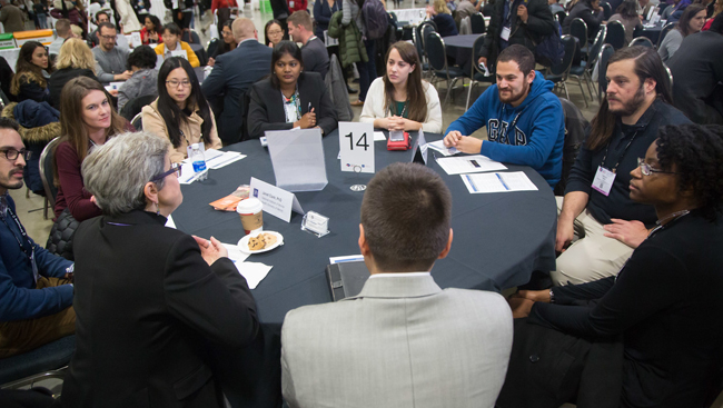 Image of several people engaging in a roundtable discussion at Neuroscience 2017