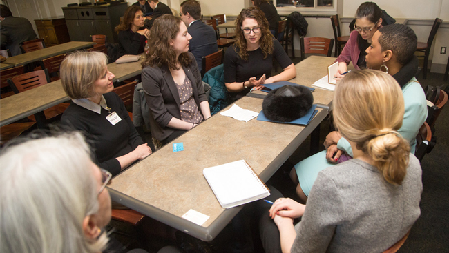 Image of several people having a discussion around a table at Capitol Hill Day 2018.