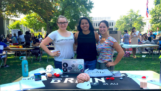 Samantha White poses with friends at an outreach event