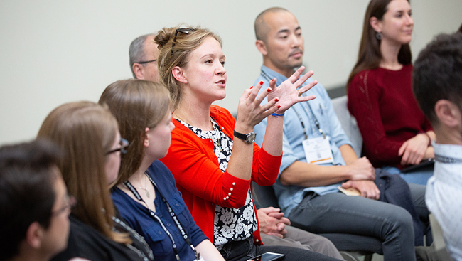 Meeting attendee speaking in a breakout group at Neuroscience 2018