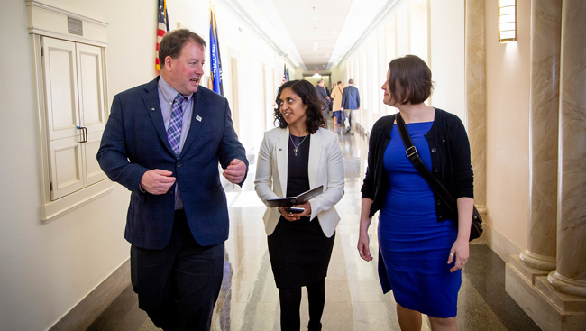Early Career Policy Ambassadors walk alongside a member of Congress at SfN's Capitol Hill Day 2019