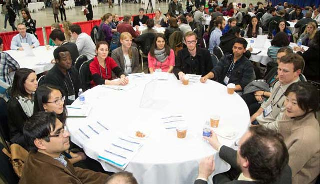 A group of mentors and proteges have a round table discussion.