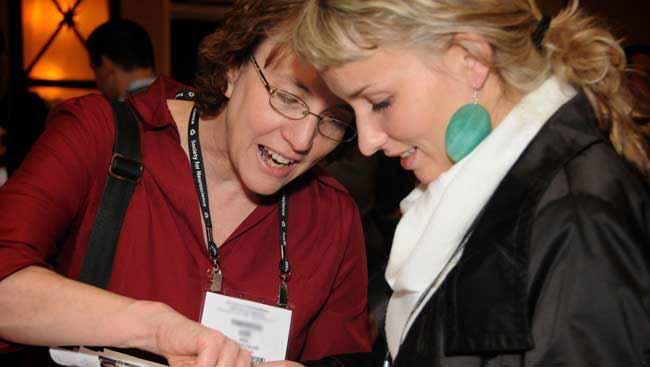 Two females discuss scientific work.