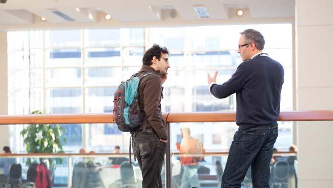 A mentor and protégé have a discussion.