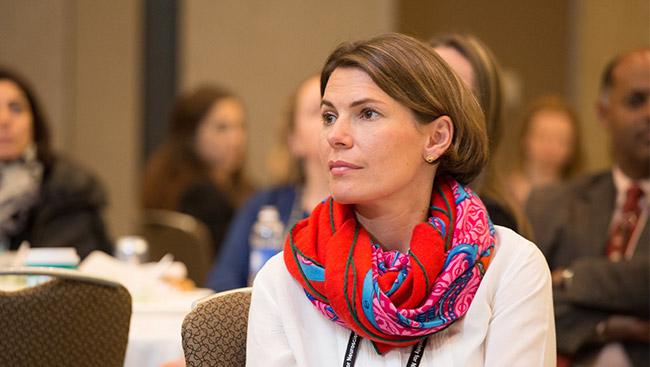 A female neuroscientist listens to a lecture.