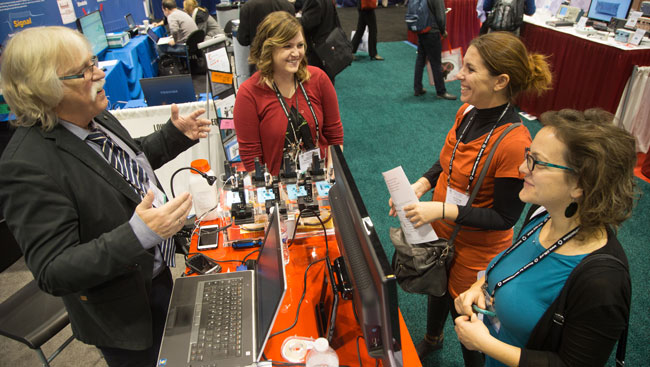 A group of neuroscientists learn about new technology at a conference.