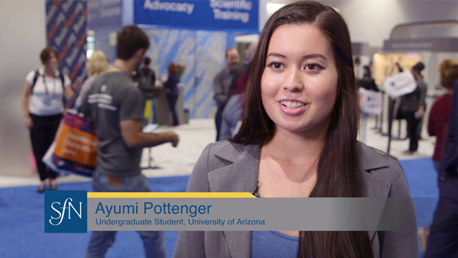 Ayumi Pottenger on the exhibit floor at Neuroscience 2018.