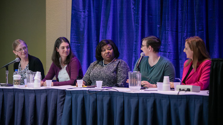 Image of five female panelists sitting at a table at Neuroscience 2019.