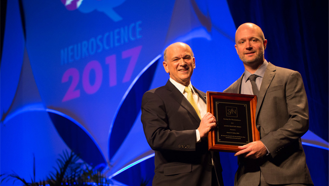 Garret Stuber receiving the Jacob P. Waletzky Award in 2017.