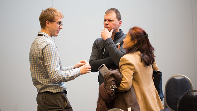 three people having a discussion during the 2017 Neurobiology of Disease Workshop