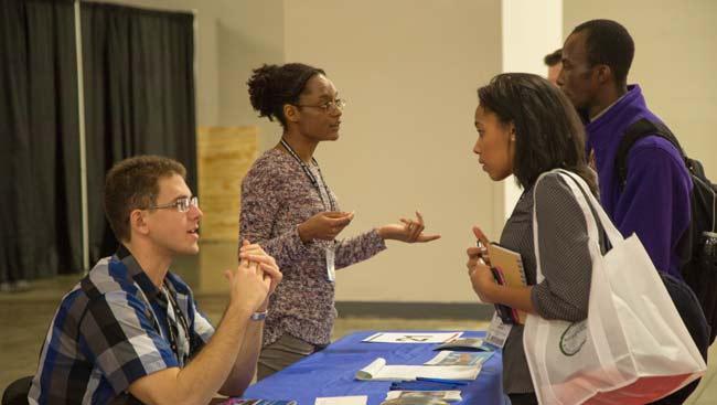 Students seek advice at a graduate school fair.