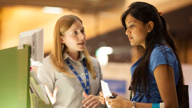 A female neuroscientist learns about new technology at a conference.