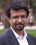 Headshot of Anirvan Ghosh wearing a white button down shirt and black jacket