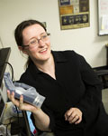 Image of Cyntha Chestek in a lab holding a robotic hand