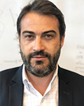 Headshot of Evangelos Kiskinis.