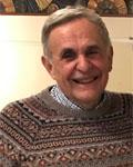 Image of Nick Ingoglia smiling wearing a sweater.